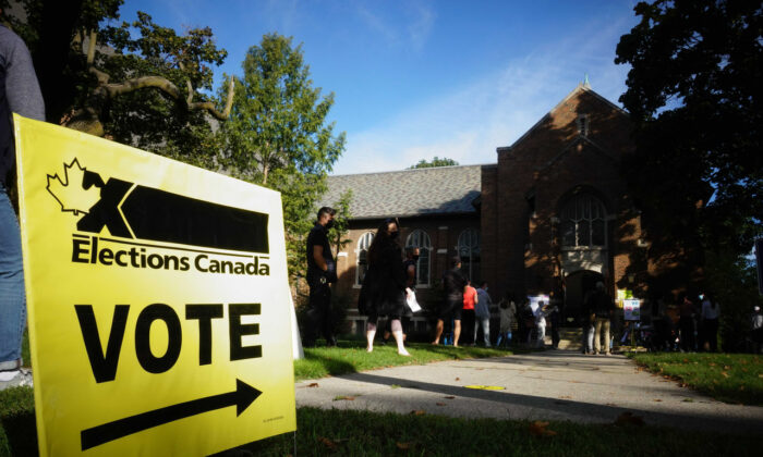 People start to line up early for the Canadian general election before polls open in west-end Toronto on Sept. 20, 2021. (The Canadian Press/Graeme Roy)