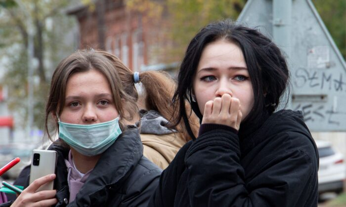 Students stand near the Perm State University in Perm, about 1,100 kilometers (700 miles) east of Moscow, Russia, on Sept. 20, 2021.(Anastasia Yakovleva/AP Photo)