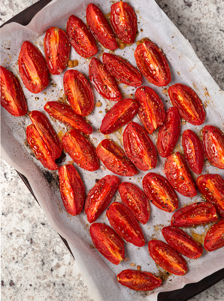 Overhead,View,Of,Roasted,Roma,Tomatoes,In,Preparation,For,Making