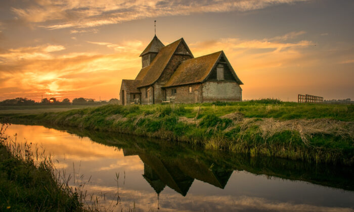 St. Thomas Becket, which dates to the 13th century, in Fairfield is arguably the most iconic of Romney Marsh churches. (Sixpixx/Shutterstock)