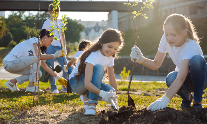 Children benefit from volunteering work; when they are older and get a first job, they can choose a charity to support. (Dmytro Zinkevych/Shutterstock)