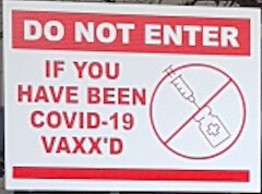 A sign warning vaccinated people not to enter at the store in Adelaide, South Australia. (Supplied)