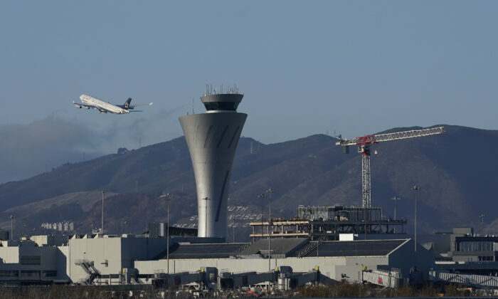 A plane takes off behind the air traffic control tower at San Francisco International Airport in San Francisco on Nov. 24, 2020. (Jeff Chiu/AP Photo)