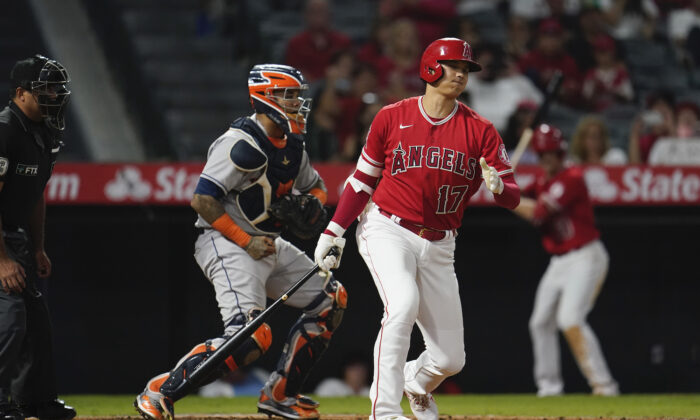 Los Angeles Angels' Shohei Ohtani (17) strikes out during the sixth inning of a baseball game against the Houston Astros in Anaheim, Calif., on Sept. 20, 2021. (AP Photo/Marcio Jose Sanchez)