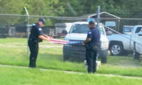 Photos Show Sheriff's Deputies Folding American Flag Saved From Barbwire Fence After Hurricane Ida