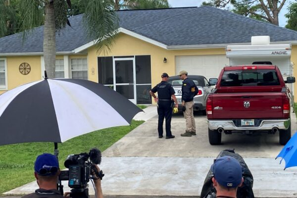 Law enforcement officials investigate home of Brian Laundrie