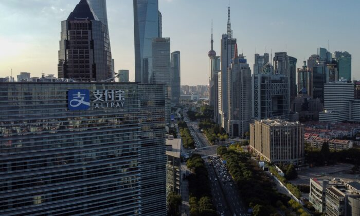 This aerial photo shows the logo (L) of China's pioneering digital payments firm Alipay on the office block of its parent company Ant Group in Shanghai on Nov. 4, 2020. (Hector Retamal/AFP via Getty Images)