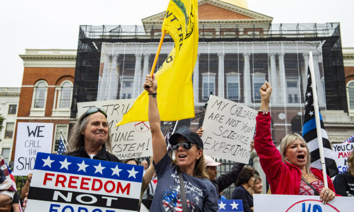 Demonstrators gather outside the Massachusetts State House to protest COVID-19 vaccination and mask mandates in Boston on Sept. 17, 2021. (Joseph Prezioso/AFP via Getty Images)