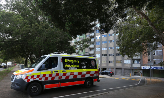 A NSW ambulance is seen departing a housing tower on Morehead Street in Redfern, Sydney, Australia, on Sept. 16, 2021. (Lisa Maree Williams/Getty Images)