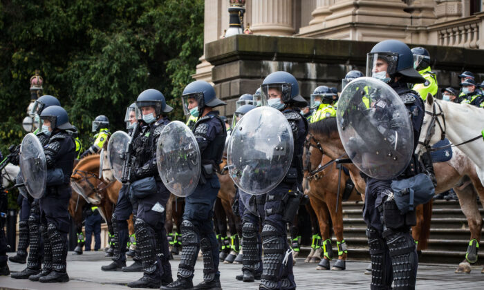 Members of Victoria Police stand on the steps of Parliament House in Melbourne, Australia, on Sept. 21, 2021. (Darrian Traynor/Getty Images)