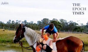 Little Boy Helps Sister Climb Up Horse