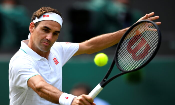 Switzerland's Roger Federer in action during his third round match against Britain's Cameron Norrie, at Wimbledon, England, on July 3, 2021. (Toby Melville/Reuters)