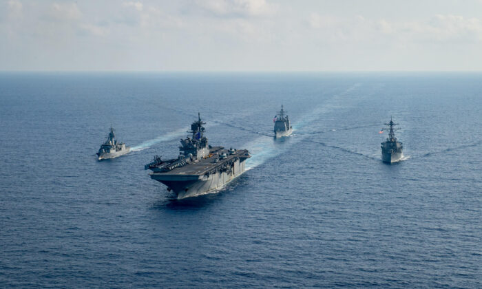 Royal Australian Navy guided-missile frigate HMAS Parramatta (FFH 154) (L) sails with U.S. Navy Amphibious assault ship USS America (LHA 6), Ticonderoga-class guided-missile cruiser USS Bunker Hill (CG 52) and Arleigh-Burke class guided missile destroyer USS Barry (DDG 52) in the South China Sea, on April 18, 2020. (Petty Officer 3rd Class Nicholas Huynh/U.S. Navy/Handout via Reuters)