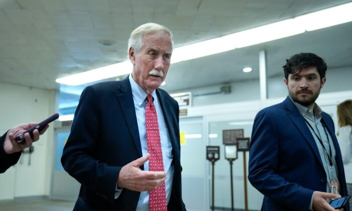 Sen. Angus King (I-Maine) talks with reporters as he walks through the Senate subway on his way to a vote at the Capitol in Washington on June 21, 2021. (Drew Angerer/Getty Images)