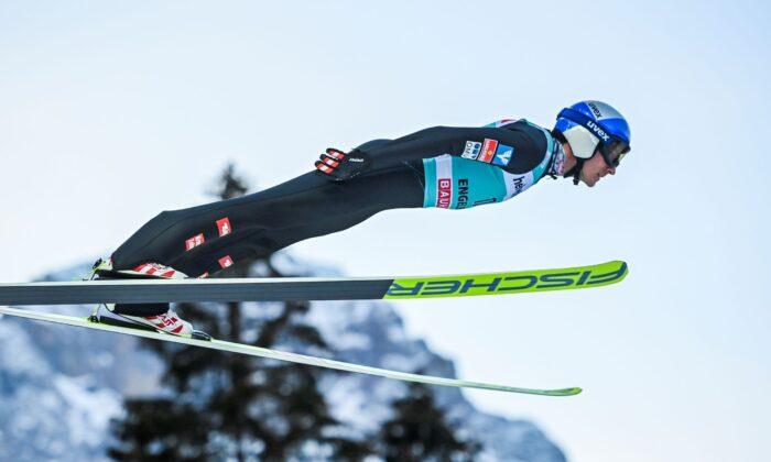 Gregor Schlierenzauer of Austria in action at the men's ski jumping FIS World Cup at the Titlisschanze in Engelberg, Switzerland, on Dec. 20, 2020. (Gian Ehrenzeller/Keystone via AP)