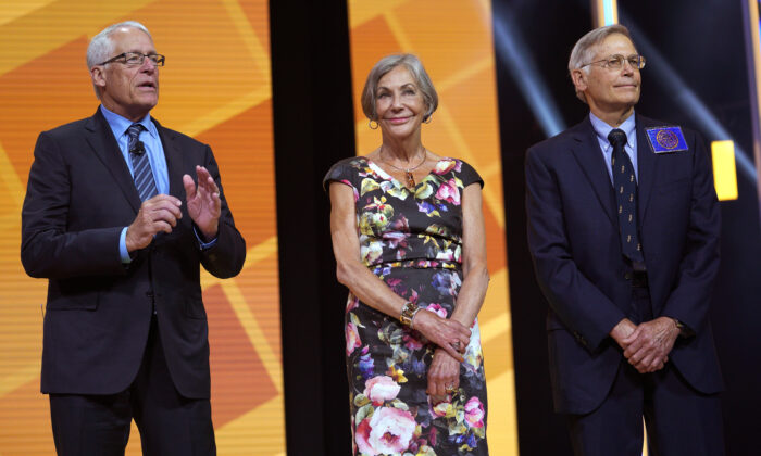 Members of the Walton family (L-R) Rob, Alice, and Jim speak during the annual Walmart shareholders meeting event in Fayetteville, Ark., on June 1, 2018. (Rick T. Wilking/Getty Images)