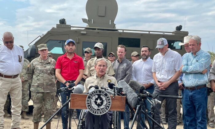 Texas Gov. Greg Abbott, with state and local officials, speaks about the border crisis under the international bridge in Del Rio, Texas, on Sept. 20, 2021. (Charlotte Cuthbertson/The Epoch Times)