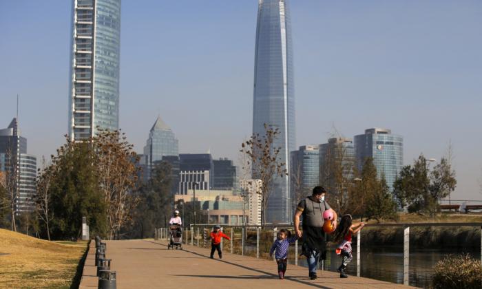 People walk on a park in Santiago, on July 30, 2021. (Javier Torres/AFP via Getty Images)