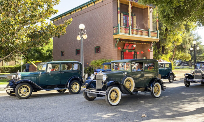 Antique cars line the street in front of the Chinese American Historical Museum at the Ng Shing Gung during Antique Autos in History Park in San Jose, Calif., on Sept. 19, 2021. (Ilene Eng/The Epoch Times)