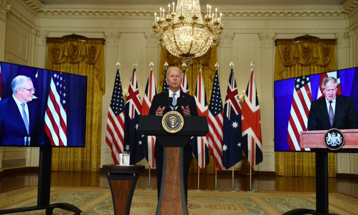 U.S. President Joe Biden participates in a virtual press conference on national security with British Prime Minister Boris Johnson (R) and Australian Prime Minister Scott Morrison at the White House in Washington, D.C., on Sept. 15, 2021. The three leaders announced the AUKUS defence partnership between their countries. (Brendan Smialkowski/AFP via Getty Images)