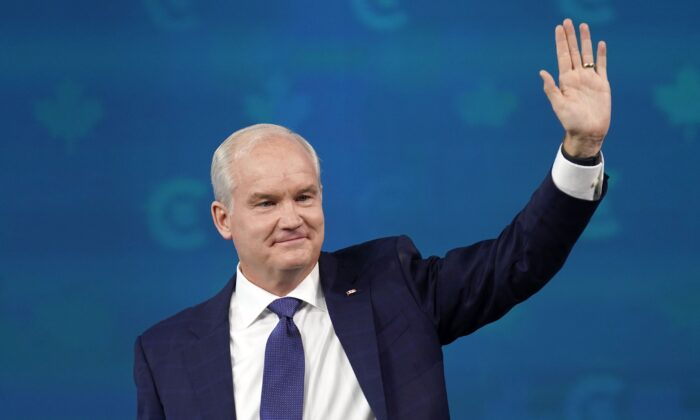 Conservative Party Leader Erin O'Toole waves after giving his concession speech at his election night headquarters in Oshawa, Ont., on Sept. 21, 2021. (The Canadian Press/Adrian Wyld)
