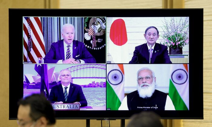 A monitor displaying a virtual meeting with U.S. President Joe Biden (top L), Australia's Prime Minister Scott Morrison (bottom L), Japan's Prime Minister Yoshihide Suga (top R), and India's Prime Minister Narendra Modi is seen during the virtual Quadrilateral Security Dialogue (Quad) meeting, at Suga's official residence in Tokyo, on March 12, 2021. (Kiyoshi Ota / POOL / AFP)