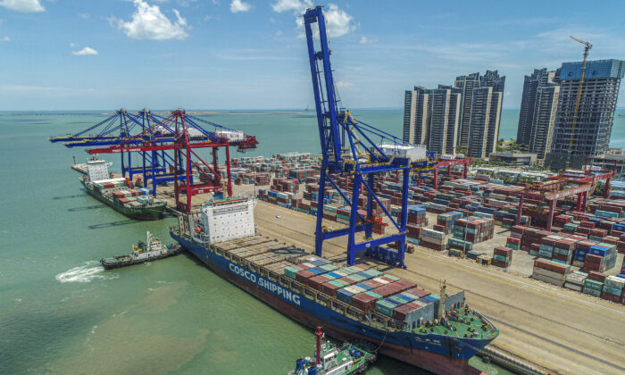 A cargo ship loaded with containers berthing at a port in Haikou in China's southern Hainan Province, on May 17, 2021. (STR/AFP via Getty Images)