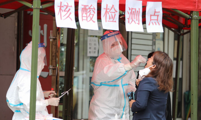 A resident undergoes a nucleic acid test for the Covid-19 coronavirus in Harbin, in China's northeastern Heilongjiang province on September 22, 2021. (STR/AFP via Getty Images)