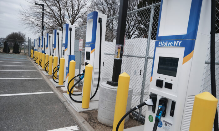 A fast-charging station for electric vehicles stands in the cell phone lot at John F. Kennedy airport in New York City on April 2, 2021. (Spencer Platt/Getty Images)