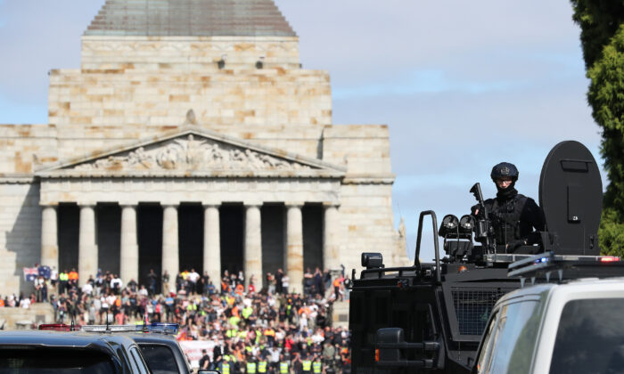 Protesters are seen at the Shrine of Remembrance as Victorian Police patrol the area in Melbourne, Australia, on Sept. 22, 2021. (Asanka Ratnayake/Getty Images)
