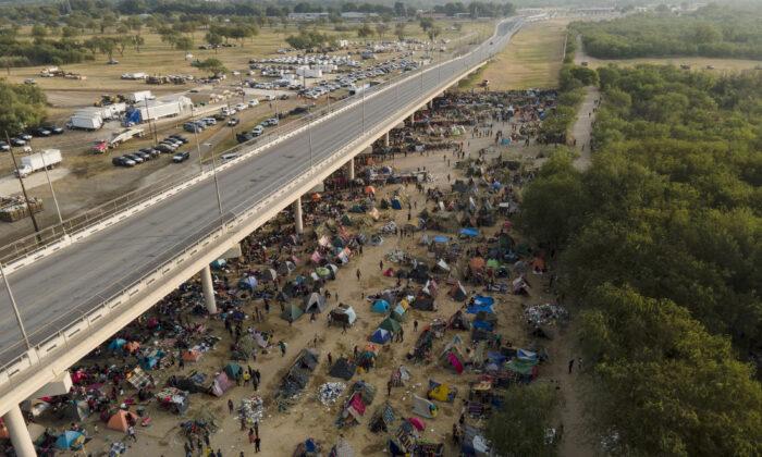 Illegal immigrants, many from Haiti, are seen at an encampment along the Del Rio International Bridge near the Rio Grande in Del Rio, Texas, on Sept. 21, 2021. (Julio Cortez/AP Photo)