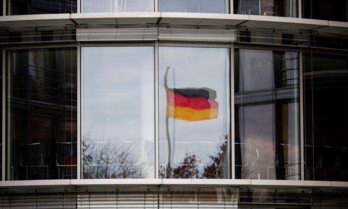 A German flag is reflected in the window of the Paul Loebe building in Berlin, Germany on November 19, 2020. (Hannibal Hanschke/Reuters)