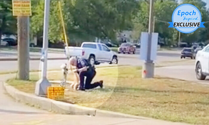 Officer Jeff Stagg picking up trash from the memorial site of a crash victim at the intersection of Rockville Road and Lyndhurst Drive, Indianapolis. (Courtesy of Kaleb Hall)