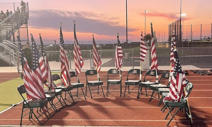 Campo Verde High School varsity football team carried 13 American flags to the field to honor the 13 service members killed Aug. 26 in Afghanistan. Kathleen Diggs, counselor and community service coordinator at Campo Verde, said the flags were then set up near the field with 13 empty chairs. (Zach Alvira on Twitter)
