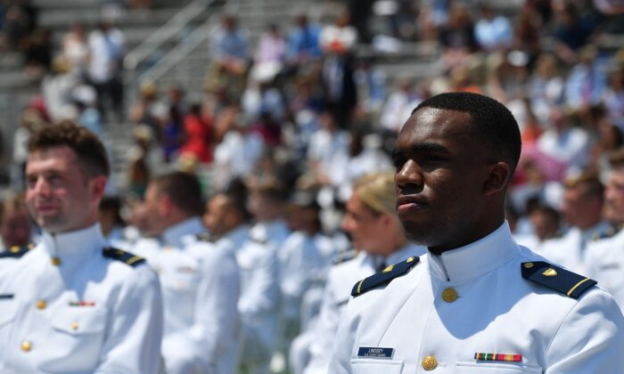 Members of the US Coast Guard attend the US Coast Guard Academy's 140th commencement exercises in New London, Connecticut on May 19, 2021. (Nicholas Kamm/AFP via Getty Images)