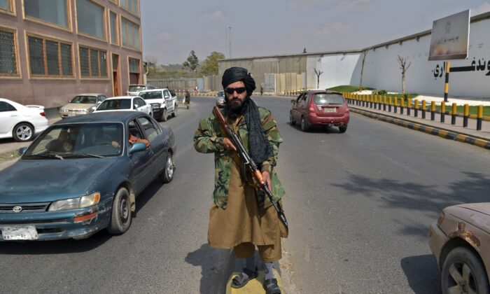 A Taliban fighter stands guard along a street near the Zanbaq Square in Kabul on Sept. 23, 2021. (Wakil Kohsar / AFP via Getty Images)