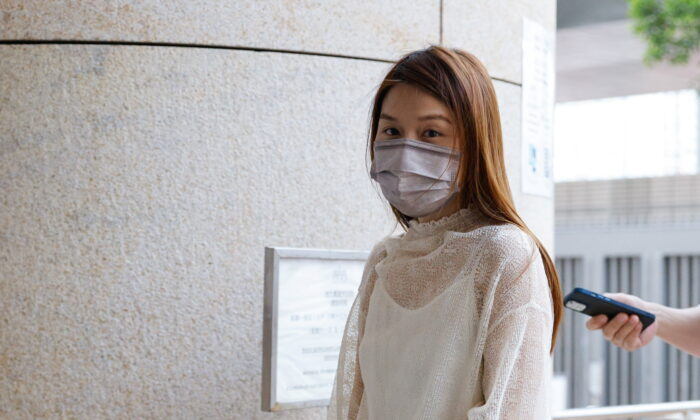 Pro-democracy activist Clarisse Yeung Suet-ying, one of the 47 pro-democracy activists charged with conspiracy to commit subversion under the national security law, arrives at West Kowloon Magistrates's Courts building, in Hong Kong, on Sept. 23, 2021. (Tyrone Siu/Reuters)