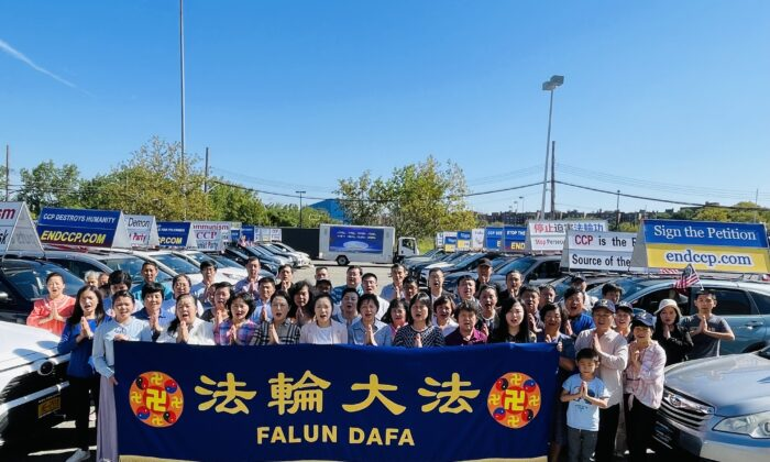 Part of Falun Gong practitioners salute their master Li Hongzhi and wish  him a happy Mid-Autumn Festival in New York City, on Sept. 12, 2021. (Lin Dan/The Epoch Times)