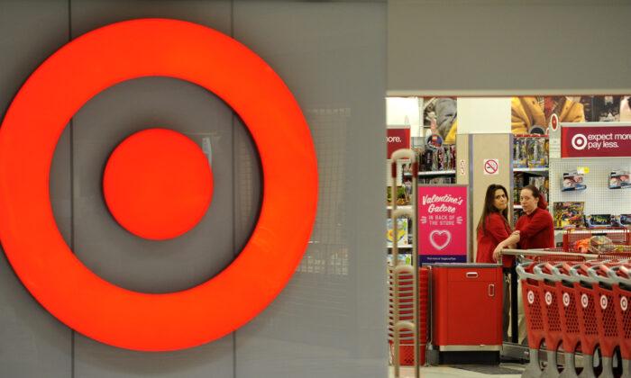 Employees work at a Target store at St. Albert, Alberta, Canada, on Jan. 15, 2015. (Dan Riedlhuber/Reuters)