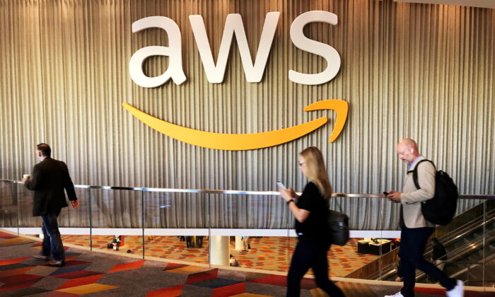 Attendees at Amazon.com Inc.'s annual cloud computing conference walk past the Amazon Web Services logo in Las Vegas, Nev., on Nov. 30, 2017. (Salvador Rodriguez/Reuters)