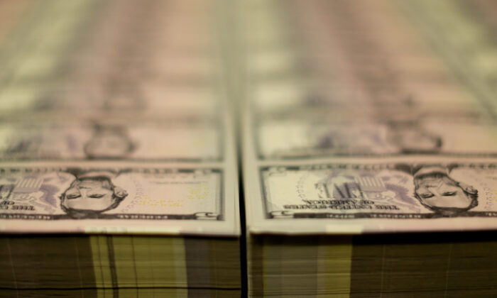 Stacks of former U.S. President Abraham Lincoln on the five-dollar bill are seen at the Bureau of Engraving and Printing in Washington, on March 26, 2015. (Gary Cameron/Reuters)