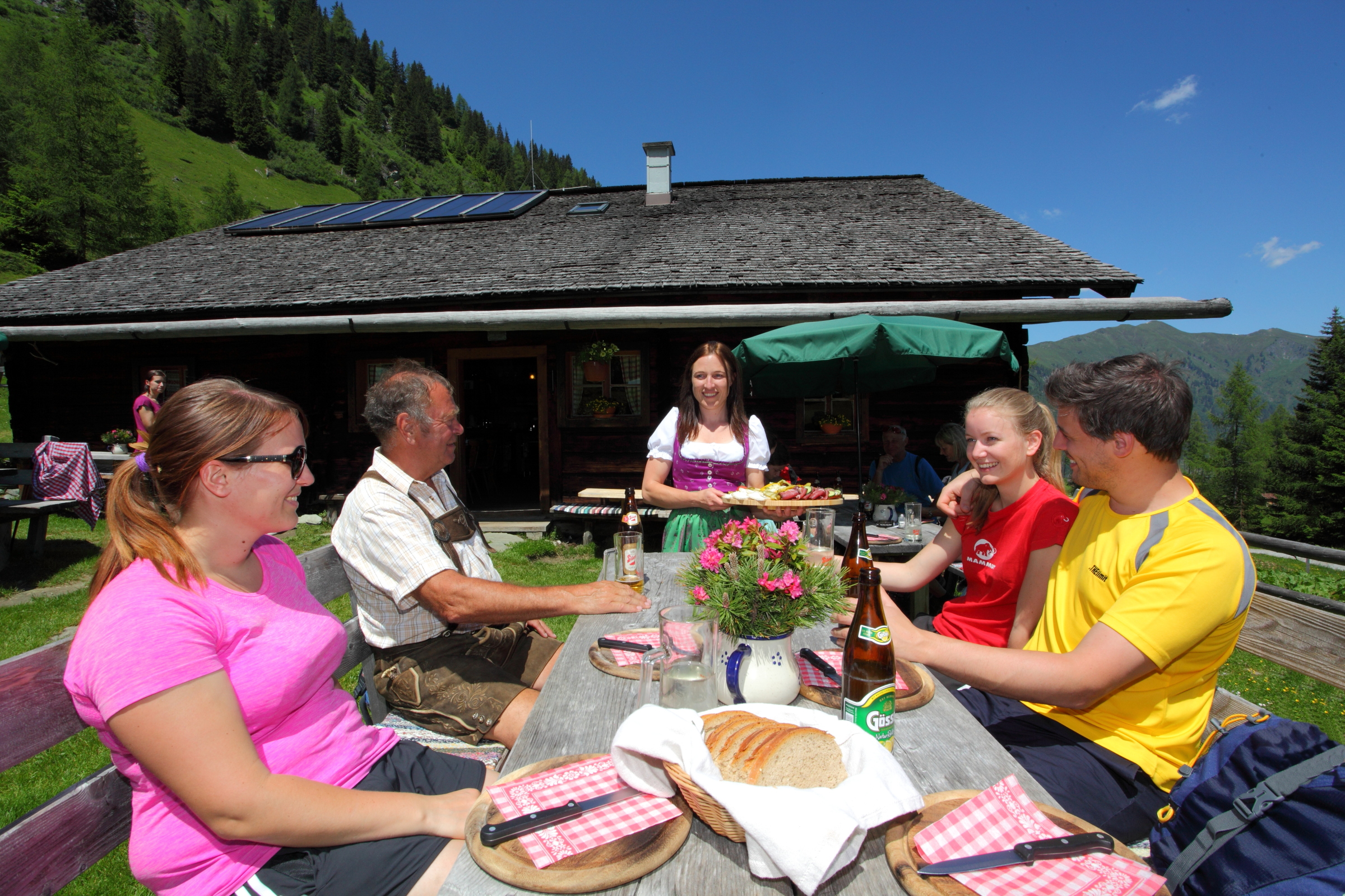 hikers lunching at an alpine hut copyright Grossarltal Tourism