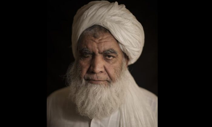 Taliban leader Mullah Nooruddin Turabi poses for a photo in Kabul, Afghanistan, on Sept. 22, 2021. Mullah Turabi, one of the founders of the Taliban, says the hard-line movement will once again carry out punishments like executions and amputations of hands, though perhaps not in public. (AP Photo/Felipe Dana)
