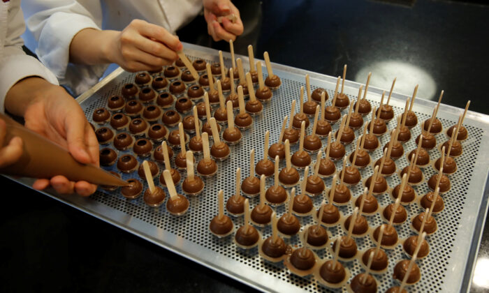 Employees of chocolate and cocoa product maker Barry Callebaut prepare chocolates after the company's annual news conference in Zurich, Switzerland, on Nov. 7, 2018. (Arnd Wiegmann/Reuters)