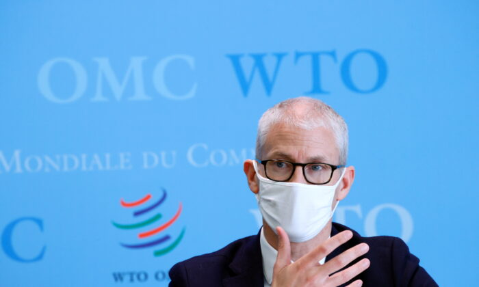 Franck Riester, France's minister delegate for foreign trade and economic attractiveness, speaks at a joint news conference with the French finance minister and WTO's director-general at WTO headquarters in Geneva, Switzerland, on April 1, 2021 (Denis Balibouse/Reuters)