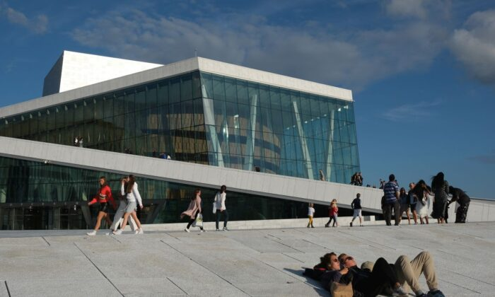 People relax outside the Oslo Opera House during the novel coronavirus pandemic in Oslo, Norway, on July 27, 2020. (Sean Gallup/Getty Images)