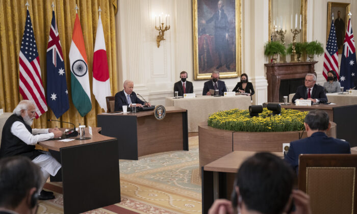 U.S. President Joe Biden (C) hosts a Quad leaders summit along with Indian Prime Minister Narendra Modi, Australian PM Scott Morrison, and Japanese PM Suga Yoshihide in the East Room of the White House on Sept. 24, 2021. The four leaders are expected to discuss a range of topics including climate change, Covid-19 vaccines and a free and open Indo-Pacific ocean region. (Pool/Getty Images)