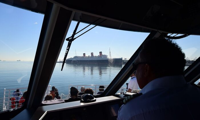 Captain Dan Salas leads a whale watching tour cruise out of Long Beach harbour past the Queen Mary in Long Beach, Calif., on January 12, 2016. (Frederic J. Brown/AFP via Getty Images)