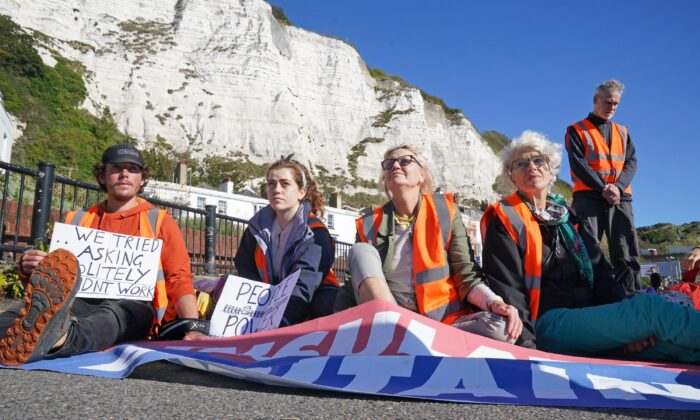 Protesters from Insulate Britain block the A20 in Kent, which provides access to the Port of Dover, on Sept. 24, 2021. (Gareth Fuller/PA)
