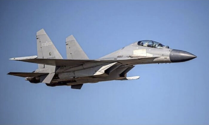 A Chinese PLA J-16 fighter jet flies in an undisclosed location in a file photo. (Taiwan Ministry of Defense via AP)